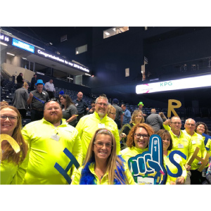 Photo- strategic HR inc team cheering in the stands at the Best Places to Work pep rally