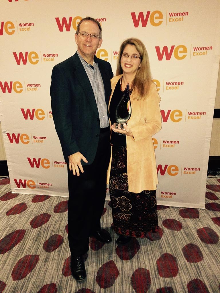 strategic HR inc. president, Robin Throckmorton, is pictured with her husband, John, showcasing her newly won Woman Owned Business of the Year Award