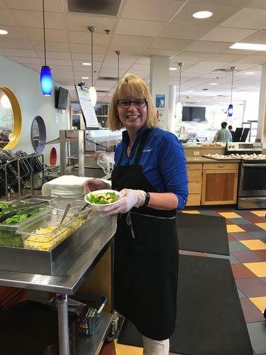 Cathleen preparing food at Ronald McDonald House