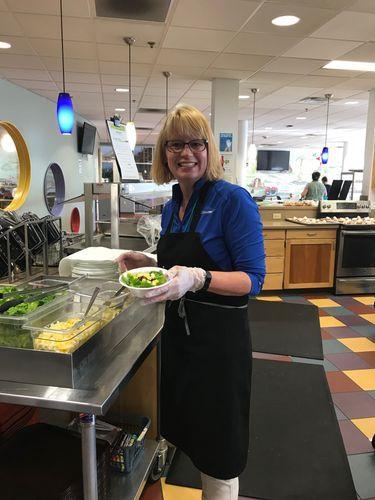 Cathleen preparing food at Ronald McDonald House