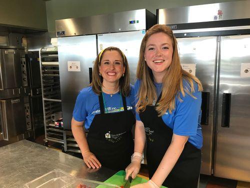 Melinda Canino & Sammie Osborne preparing meals at Ronald McDonald House