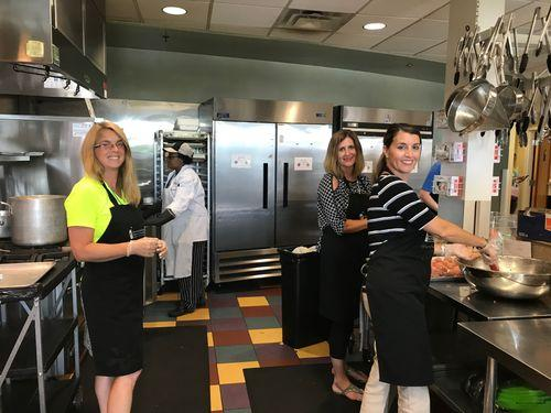 Robin Throckmorton, Alisa Fedders and Terry Salo preparing a meal at Ronald McDonald House