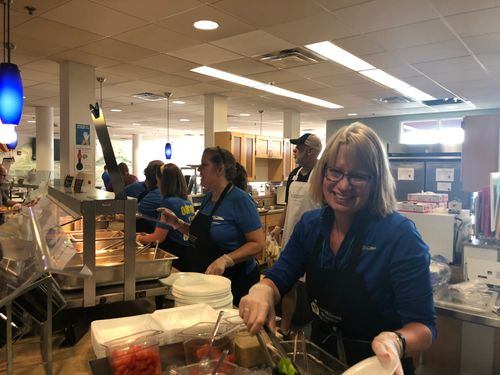 strategic HR inc. team serving dinner at Ronald McDonald House