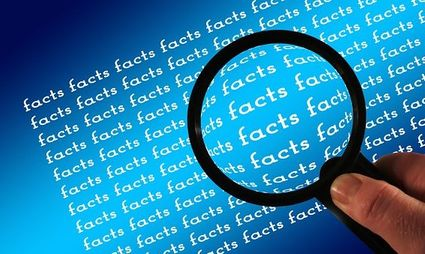 Image of magnifying glass examining facts