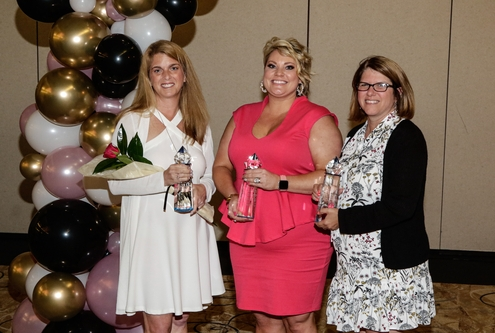 Photo of Robin Throckmorton, president of strategic HR inc., along with 2 other Women's Business Award Winners. Awards were presented by the Clermont Chamber of Commerce