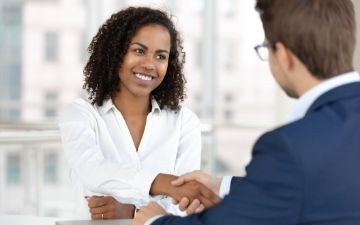 Photo of a job seeker shaking hands with a recruiter, representing Recruitment Services