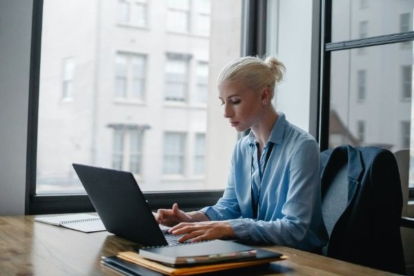 Photo of woman taking assessment on laptop